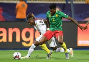 Ghana's midfielder Christian Atsu fights for the ball with Cameroon's midfielder Andre-Frank Zambo Anguissa.