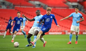 Chelsea's Timo Werner (right) holds off Manchester City's Benjamin Mendy to shoot.