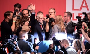 Jeremy Corbyn surrounded by people after his re-election