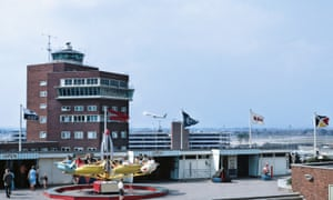 A summer's day in July 1967. Children play on the viewing terrace amusements while the control tower staff focus on the BOAC Boeing 707 taking off in the distance. From the 1950s to the 1970s, everything was done to ensure all the family was catered for, and aviation and airline travel was promoted to spectators at Heathrow