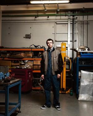 Sam Haywood, 20, apprentice prototype mechanic, Ford Dunton Technical Centre, wears Topman jumpsuit in his workplace.