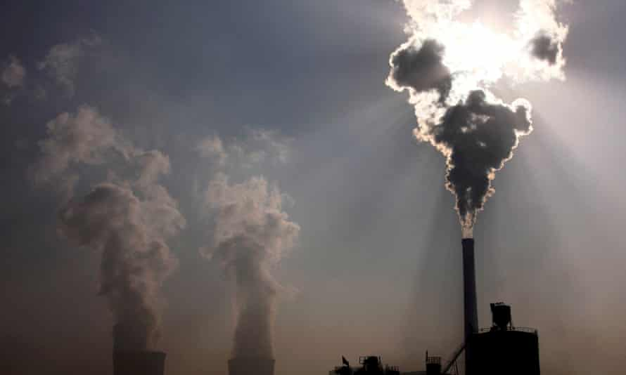 A coal power plant in China spews out smoke and dust