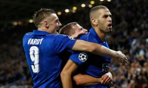 Islam Slimani celebrates with Jamie Vardy after scoring the opening goal.