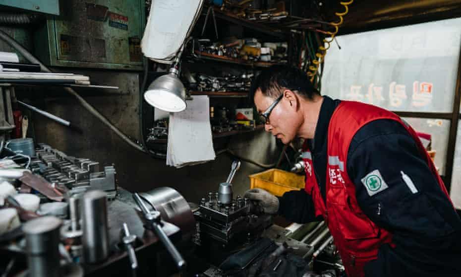 Cho Moo-ho, 60, in his metal workshop in Euljiro, Seoul.