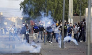 Protesters throw rocks at police as teargas is fired in Kasserine