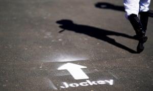 Jockeys follow signs at Newcastle Racecourse.