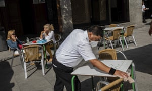 A waiter disinfects a table in central Madrid on Wednesday.