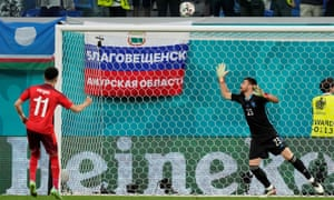 Switzerland's Ruben Vargas (left) fires over the bar during a penalty shoot-out.