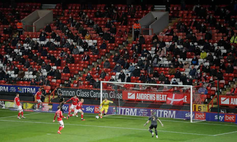 Charlton fans watch their team take on MK Dons at the Valley.