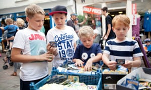 Young boys buying Pokemon cards