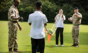 Pupils from Marlborough science academy, St Albans, take part in teambuilding exercises with army supervision