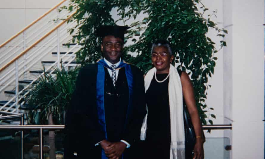 Olufemi with Tinu after receiving a master's from Coventry University in 2005.