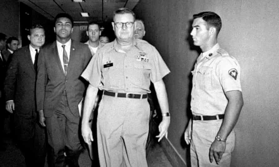 Ali is escorted from as US army facility after refusing army induction over his opposition to the Vietnam war.