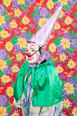 """Dancing clownsPortrait of dancing clown with the typical costume from the gang """"Cuadrilla de Juquilita"""", Coatepec, Veracruz, Mexico. They use their masks when they prefer not to reveal their identity. Veracruz, Mexico, 2016."""