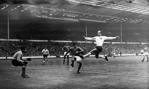 England's Bobby Charlton leaps up to get a shot in at goal during England's final group game, a 2-0 win over France.
