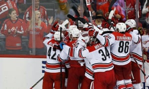 Carolina Hurricanes players celebrate after their win against the Washington Capitals