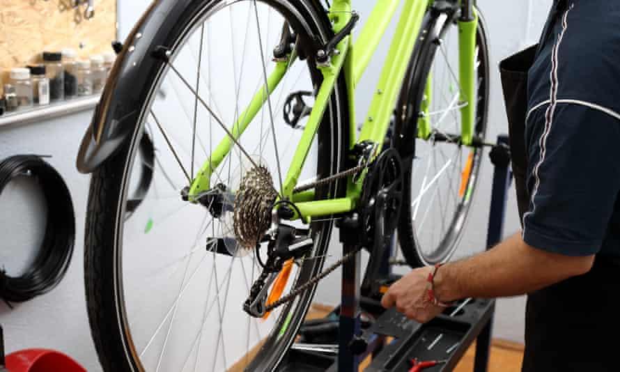 a bike mechanic at work
