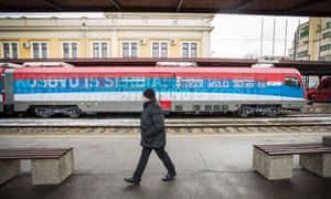 A Serbian train bearing signs reading 'Kosovo is Serbia'