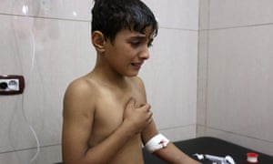 A Syrian boy is treated in hospital for breathing difficulties after an alleged chlorine gas attack in Aleppo.