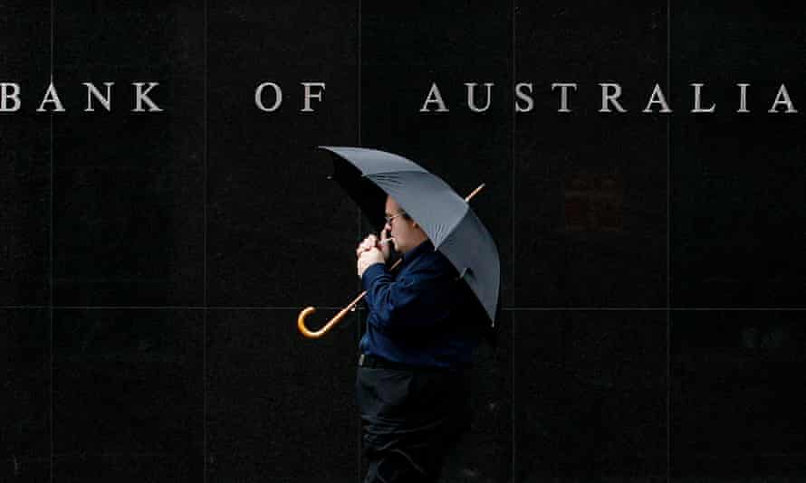 A man walks past the Reserve Bank of Australia building in central Sydney