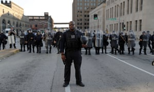 Police line up as protesters gather in downtown St. Louis on 15 September 2017.