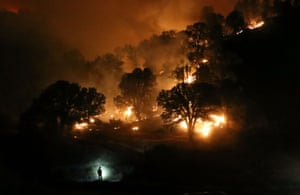 A firefighter monitors a backfire near Clearlake, California. The Rocky Fire burned over 60,000 acres and forced the evacuation of 12,000 residents.