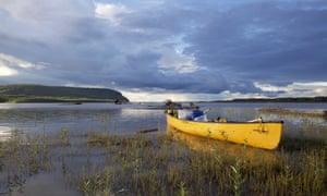 A canoe moored by the shore, Teslin River, Yukon, Canada.