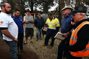 Graham Cockerell with truck drivers in Dunedoo