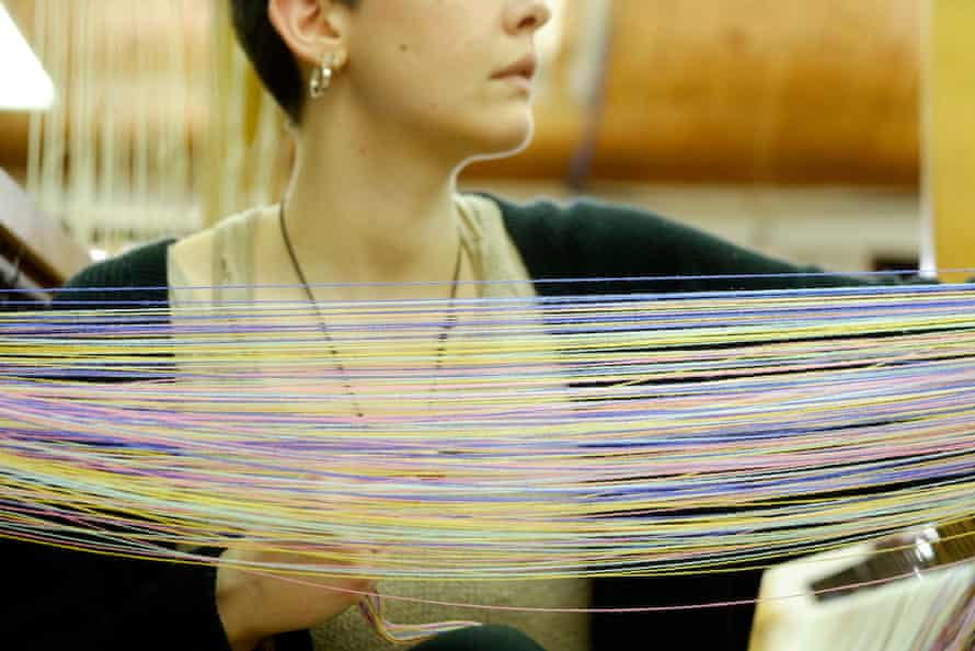 A worker at the San Patrignano Design Lab in Italy which trains recovering addicts in weaving and other crafts