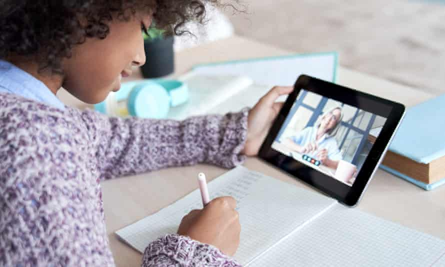 Girl holding digital tablet talking with remote teacher tutor on social distance video conference call