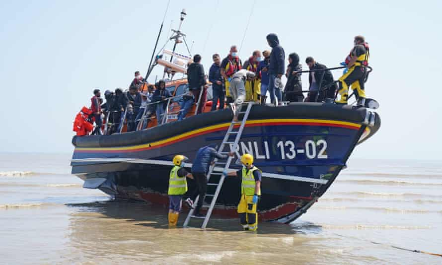 People thought to be migrants crossing from France on a lifeboat near Dungeness, Kent, this Tuesday.