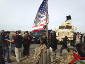 Dakota Access pipeline protesters defy law enforcement officers who are trying to force them from a camp on private land in the path of pipeline construction