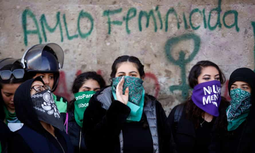 People participate in a protest against gender-based violence outside the National Palace in Mexico City, Mexico, 18 February 2020.