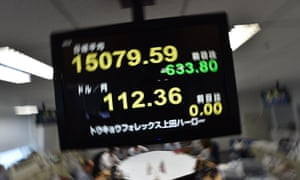 An electronic board shows a share price numbers of the Tokyo Stock Exchange. New figures show the Japanese economy shrunk at a greater rate than had been forecast.