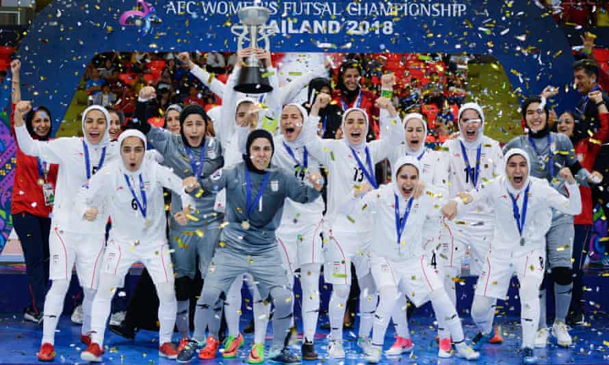Iran celebrate after beating Japan in Asian Football Confederation's Women's Futsal Championship final in May 2018.