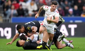 England's Oliver Gildart breaks out before scoring the decisive try against New Zealand.