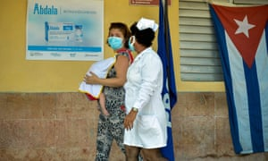 A nurse and a woman carrying her baby in Havana yesterday.