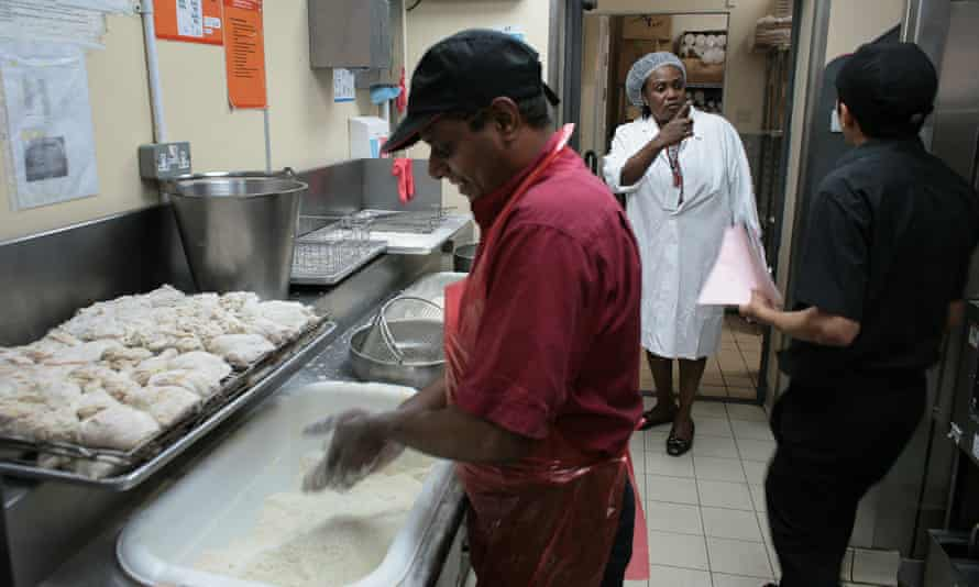 Sharon Nkansah, a food safety officer, inspects a KFC branch in Newham, east London.