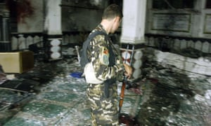 A soldier inspects the mosque where a blast killed dozens of Shia worshippers in Herat.