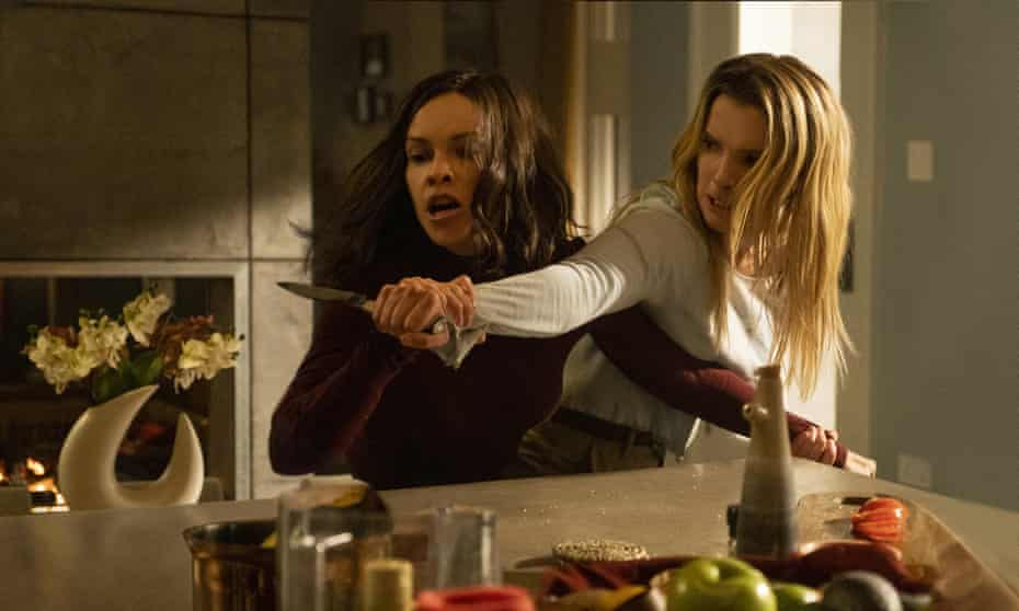 Hilary Swank and Betty Gilpin in The Hunt.