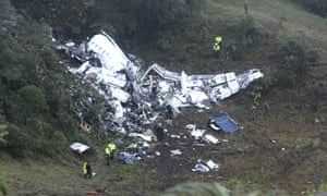 Police officers and rescue workers search for survivors around the wreckage of a chartered airplane that crashed in La Union, a mountainous area outside Medellin, Colombia,