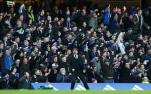 Antonio Conte celebrates in front of the joyous Blues fans after Pedro opened the scoring.