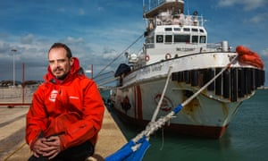 Captain Marc Reig with his rescue boat, the Open Arms.