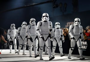 """""""Storm Troopers"""" walk in front of fans."""