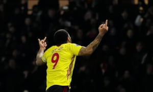 Troy Deeney celebrates after thumping in the penalty.