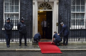 Workers fit red carpet ahead of meeting between Cameron and Xi at No 10