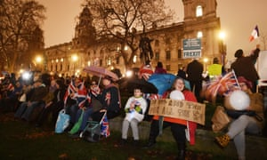 Pro Brexit supporters celebrate outside the Houses of Parliament in London