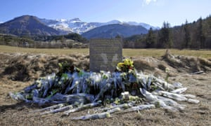 Flowers left in front of a monument to the victims of the Germanwings crash.