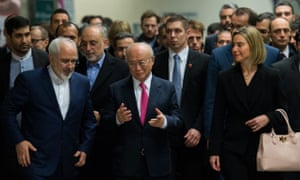 Yukiya Amano (centre) walks with Federica Mogherini and Javad Zarif