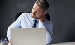 Man with neck pain sitting at laptop